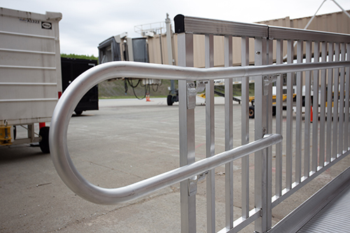 A close up of end loops on an aluminum commercial ramp.