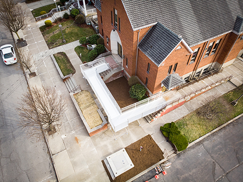 An aerial view of an aluminum commercial ramp installed outside of a school building.