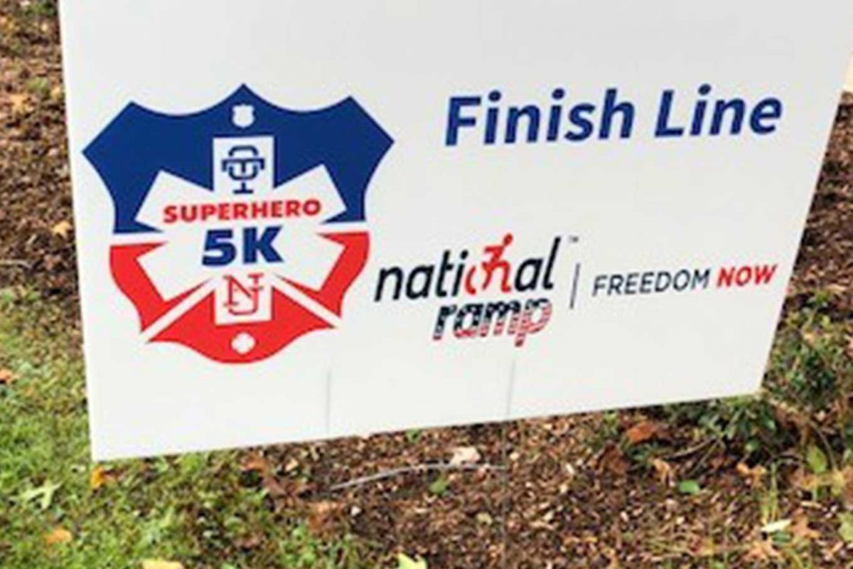 The National Ramp logo is displayed on the Finish Line sign for the Superhero 5K.