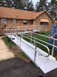 An aluminum solid decking ramp installed at the front of a house.