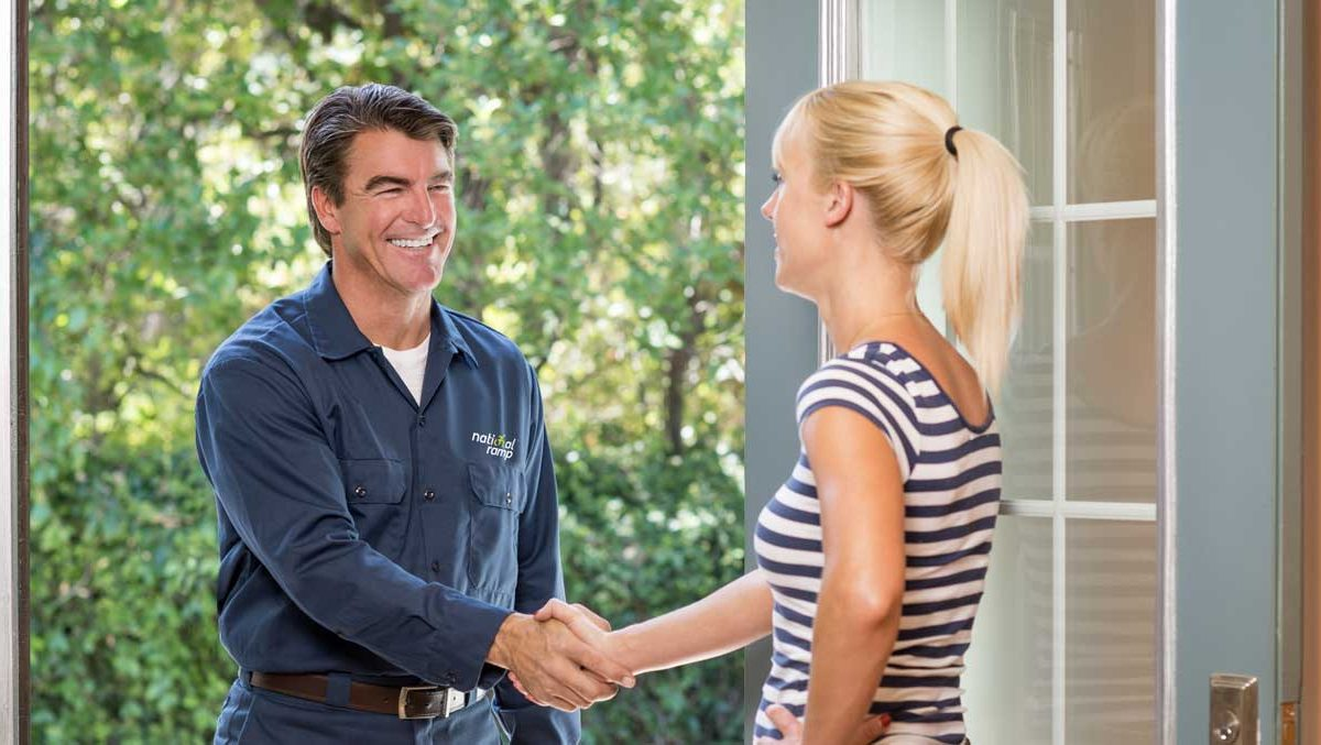 A woman greets a National Ramp dealer at her home with a handshake.