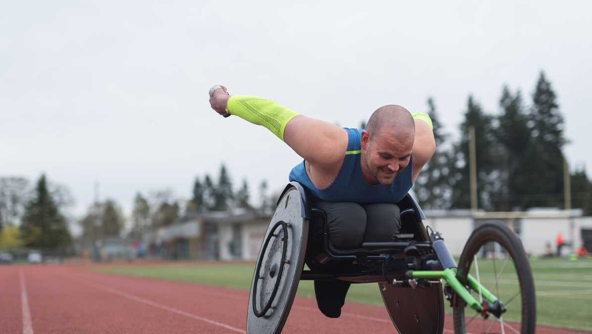 A wheelchair racer in motion.