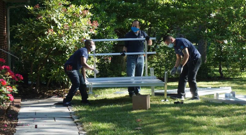 Team of installers putting a ramp together