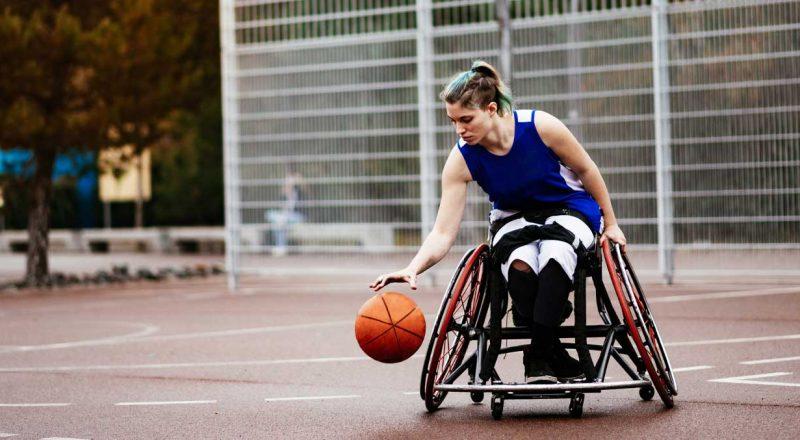 Woman playing adaptive basketball