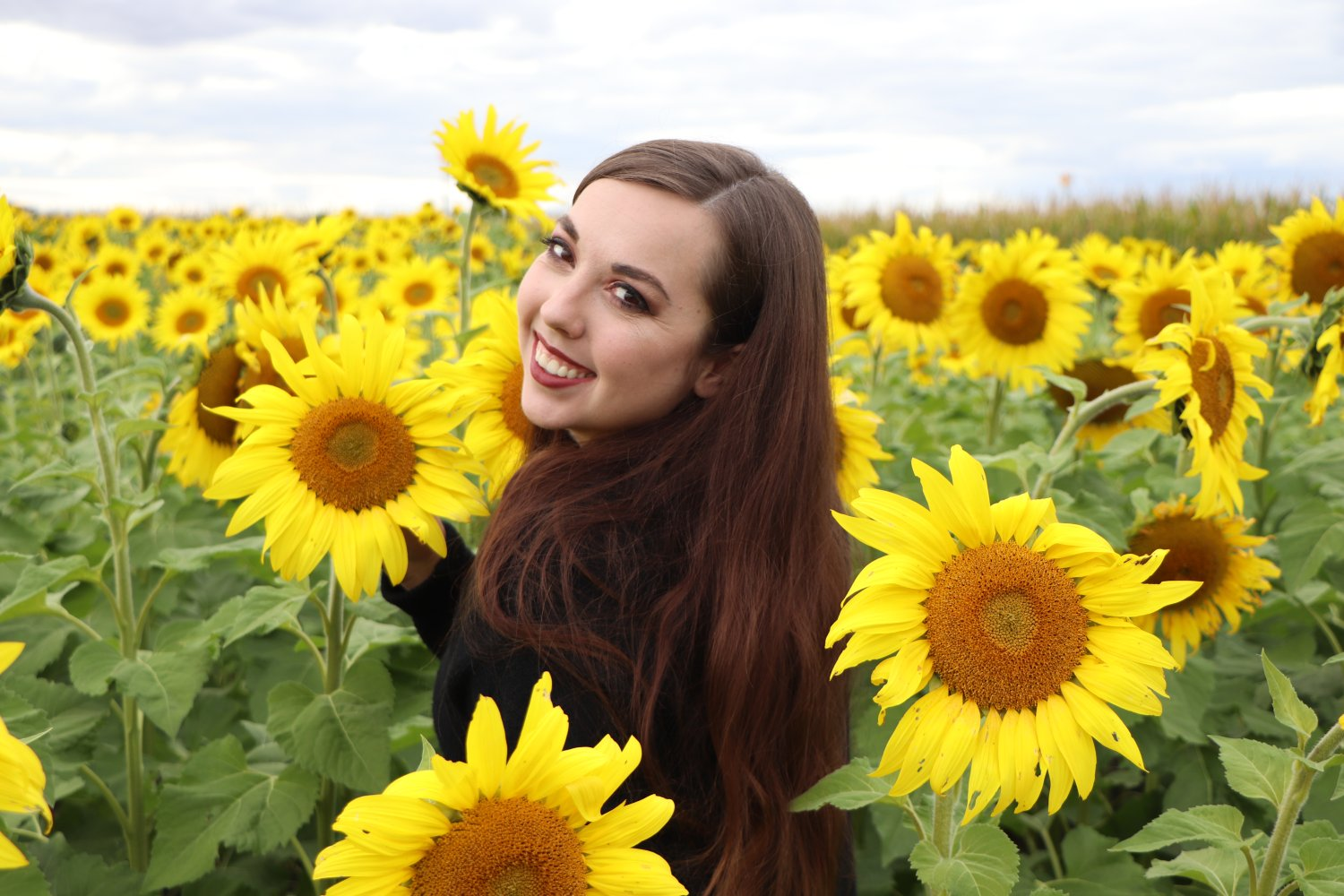 Picture of Jessica Ping-Wild in a sunflower field
